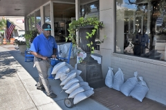 Derrick Wilson delivers and deploys sandbags at Augustus Carolina on Front Street in Georgetown. Tanya Ackerman/Coastal Observer