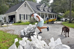 Will Keelin, 13, begins moving sandbags into place at his home on Woodville Circle in Pawleys Island. Tanya Ackerman/Coastal Observer