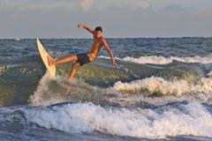 Wyatt Roff catches a few waves Wednesday night. ? Tanya Ackerman/Coastal Observer