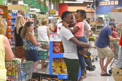 Khyjuan Tisdale plays with his sister Kyle Tisdale, 3, in line at Publix, which stayed open until noon Wednesday. Tanya Ackerman/Coastal Observer