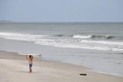 Surfer Dru Cooper looking for waves Thursday at Litchfield.? Tanya Ackerman/Coastal Observer