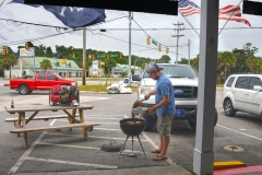 Kenny Church grills some chicken at Pawleys Island Supply Thursday afternoon. Tanya Ackerman/Coastal Observer