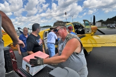 Volunteers at Cape Fear Regional Jetport unload Doug Decker's Beechcraft Bonanza A-36 filled with supplies for hurricane victims in North Carolina. Tanya Ackerman/Coastal Observer