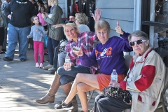 Kelli Howell, Pris Howell and Irene Swink, of Murrells Inlet, found a spot to rest in the big crowd of people.