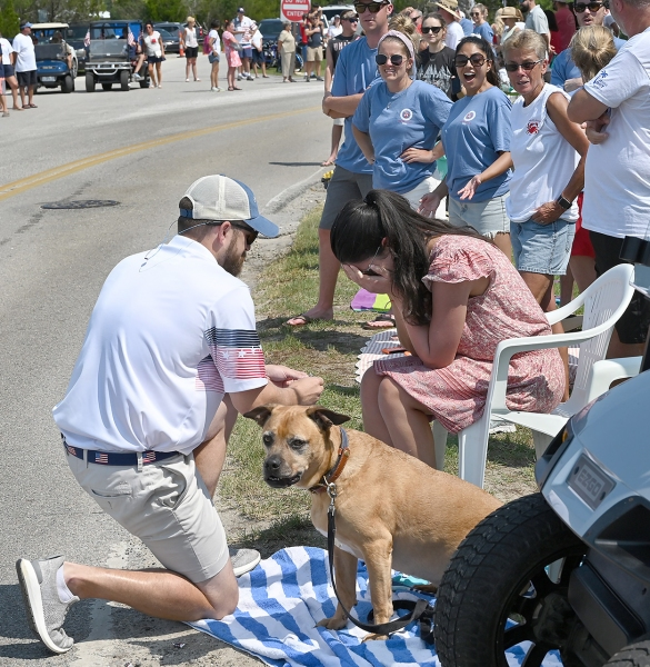 Casey Peissel proposes to Kelsey Maloney during the Pawleys Island Fourth of July Parade. Their families surprised the couple with a float in the parade, which won the prize for Most Original. She said 'Yes.'