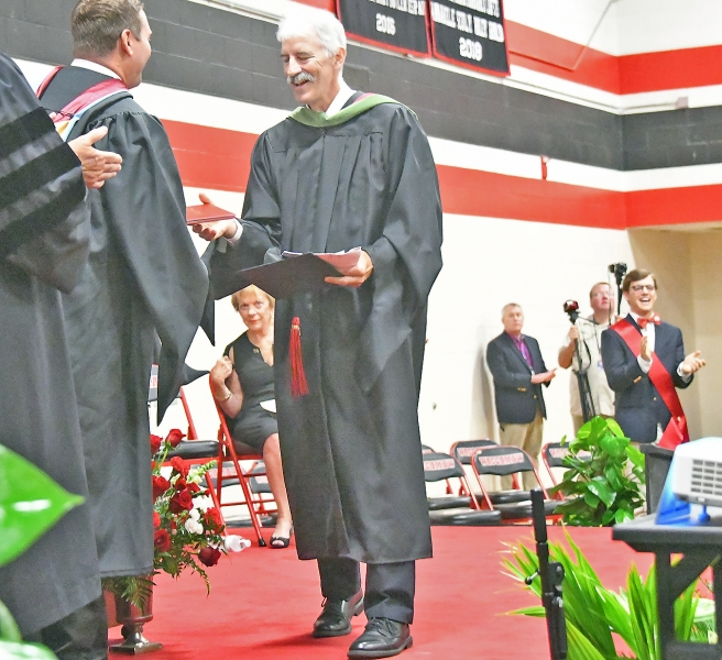 Seniors asked Scott Streiffert to walk the stage after they received their diplomas. He is retiring after 27 years at WHS.