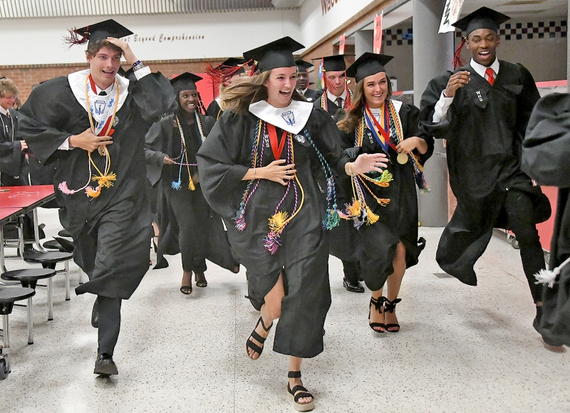 Seniors scramble to get in line for the procession at the start of the 27th Waccamaw High commencement on Wednesday. Photos by Tanya Ackerman/Coastal Observer