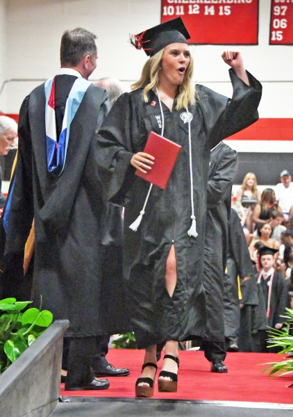 Emma Deshaw celebrates with her diploma.
