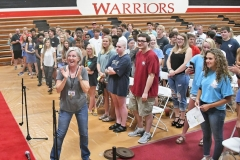 The class held a practice session on Tuesday. Sylvia Plyer, the choral teacher, claps to indicate audience applause.
