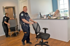 Happy to be finally moving in officers Jonathan Fairfield and Joe Giotto wheel in furniture they brought up from the old Town Hall.