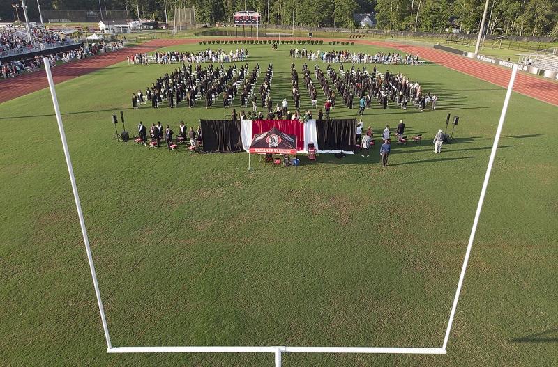 Graduates assemble on Warrior Field.